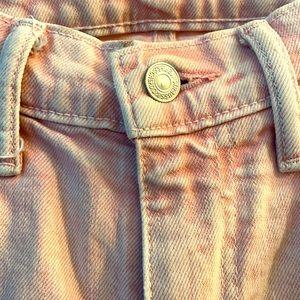 Pink wash Levi's 511 jeans
